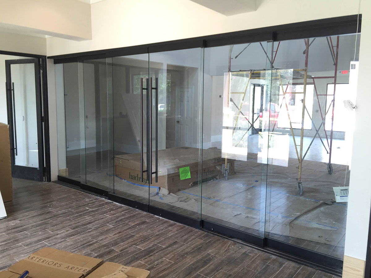 M i glass inc houston for Glass wall designs interior